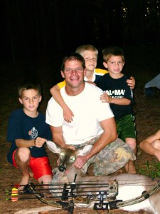 The basic tool of discipleship and fatherhood is a shared life. The McKenzie boys with Tracy's first deer with a bow.