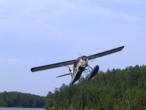 Floatplane taking off from Rushing Winds Lodge, Populus Lake, Ontario, site of the God's Great Outdoors summer Board meeting.